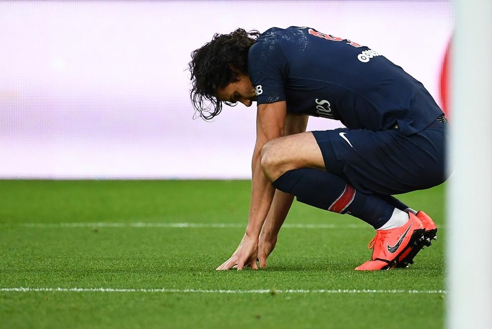 Paris Saint-Germain's forward Edinson Cavani reacts as he suffers an injury after scoring a goal during the French L1 football match against FC Girondins de Bordeaux at the Parc des Princes Stadium, in Paris Saturday. — AFP