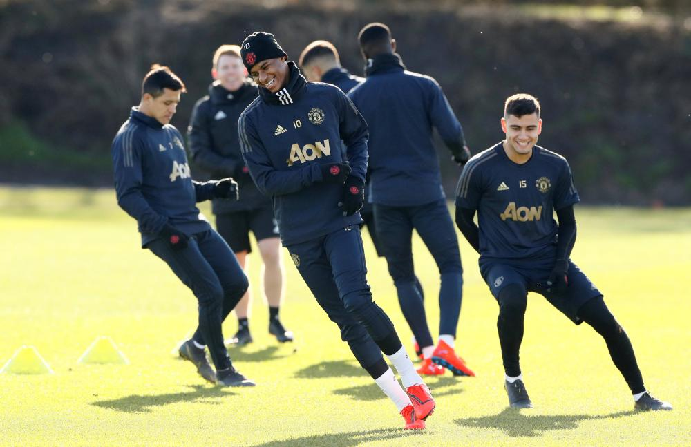 Manchester United's Marcus Rashford and Andreas Pereira train during a practice session at Aon Training Complex in Manchester Monday. — Reuters
