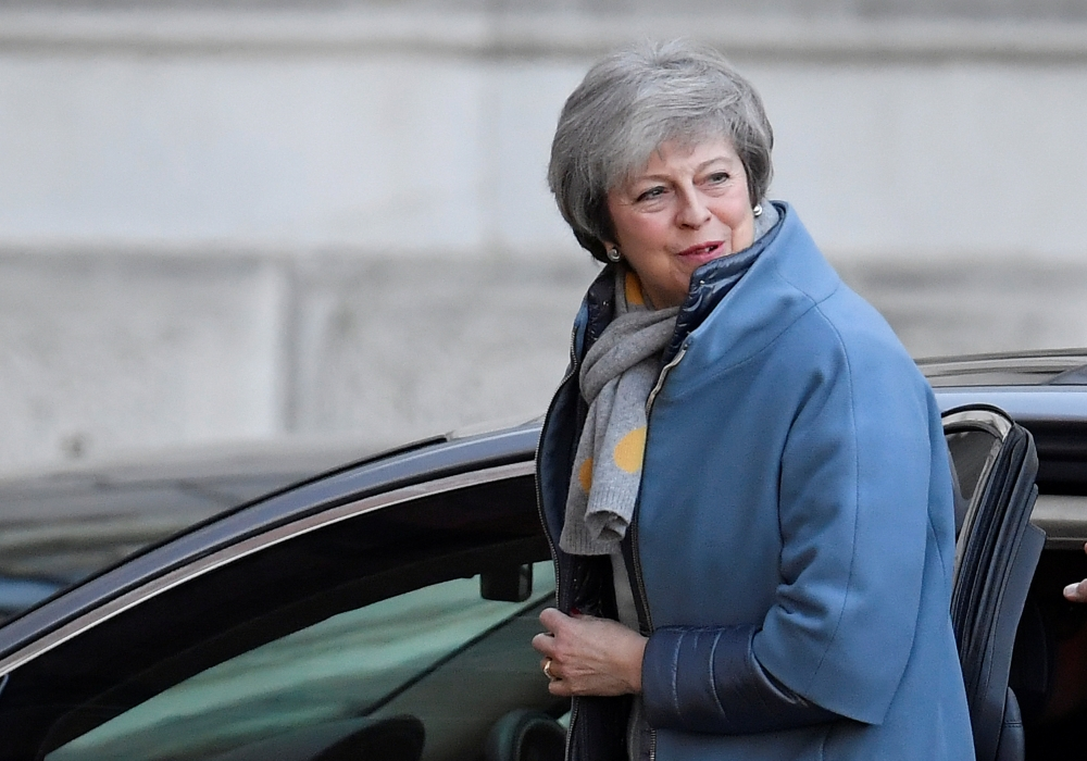 Britain's Prime Minister Theresa May returns via a back entrance to 10 Downing Street in London on Monday. — Reuters