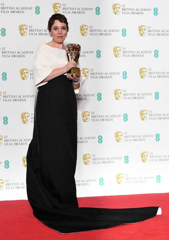 Olivia Colman holds the award for leading actress for her performance in 'The Favourite' at the British Academy of Film and Television Awards (BAFTA) at the Royal Albert Hall in London. — Reuters