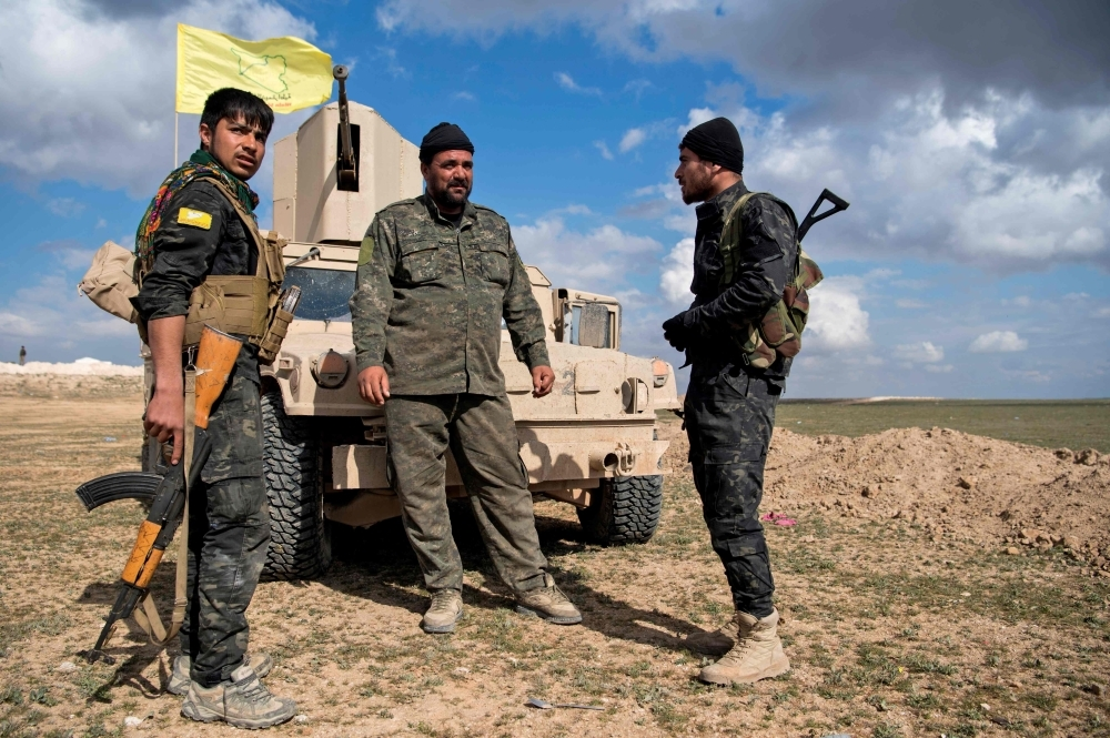 US-backed Syrian Democratic Forces (SDF) fighters gather as they prepare to expel hundreds of militants from the Baghouz area in the eastern Syrian province of Deir Ez-Zor on Tuesday. — AFP