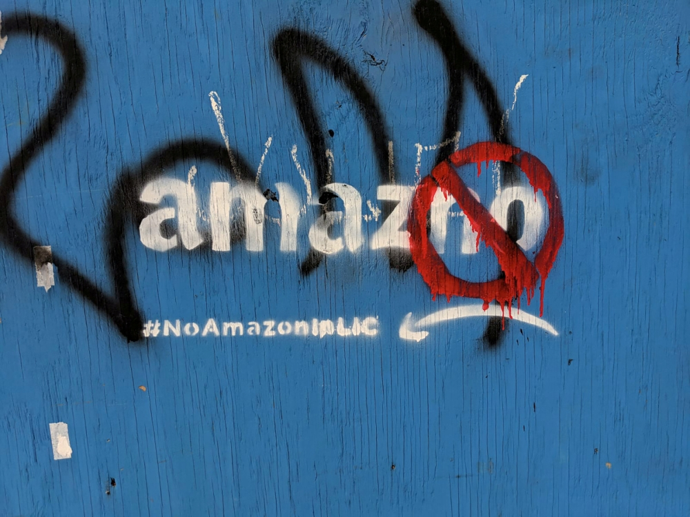 Graffiti opposing the construction of the new Amazon campus covers a fence at a vacant lot in the Long Island City neighborhood of New York City, US  in this file photo. — Reuters