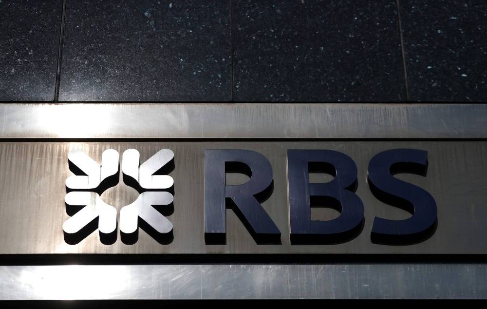 In this file photo an RBS logo is pictured above a branch of a Royal Bank of Scotland (RBS) bank branch in central London. State-rescued Royal Bank of Scotland more than doubled net profits in 2018, the lender announced on Friday, as it extends its recovery following a decade of turmoil. RBS said in a statement that profit after tax jumped to £1.62 billion ($2.10 billion, 1.84 billion euros) last year. — AFP