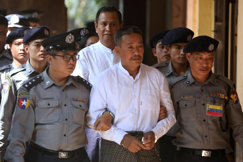 Kyi Lin and Aung Win Zaw, who are accused of the murder of Muslim lawyer Ko Ni, arrive at Insein court in Yangon, Myanmar, on Friday. — Reuters