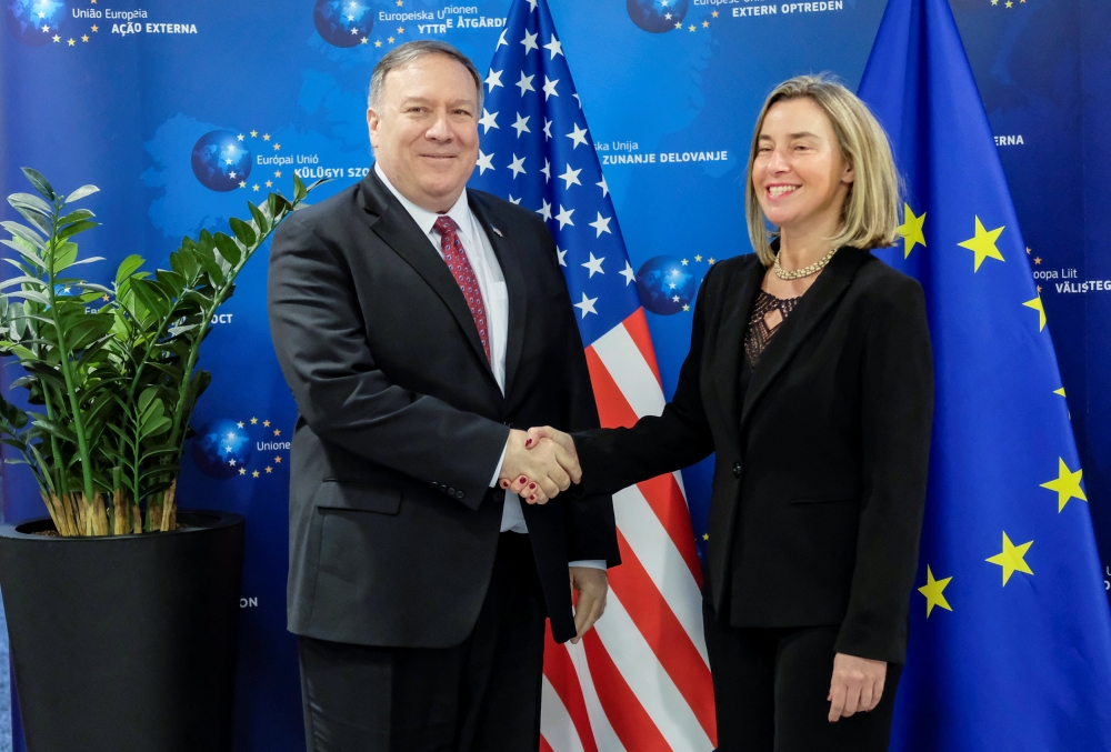 US Secretary of State Mike Pompeo poses with European Union foreign policy chief Federica Mogherini in Brussels, Belgium, on Friday. — Reuters