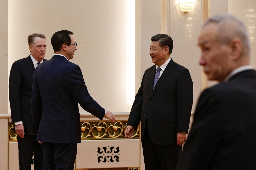 US Treasury Secretary Steven Mnuchin (2nd L) talks with Chinese President Xi Jinping as US Trade Representative Robert Lighthizer (L) and Chinese Vice Premier Liu He (R) look on before their meeting at the Great Hall of the People in Beijing on Friday. — AFP