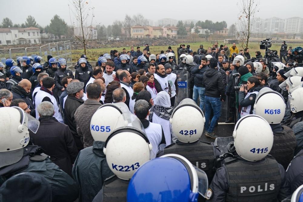 Turkish anti-riot police surround and block members of the pro-Kurdish Peoples' Democratic Party (HDP) during a demonstration in solidarity with a HDP lawmaker on hunger strike in the Turkish city of Diyarbakir, Turkey, on Friday. — AFP