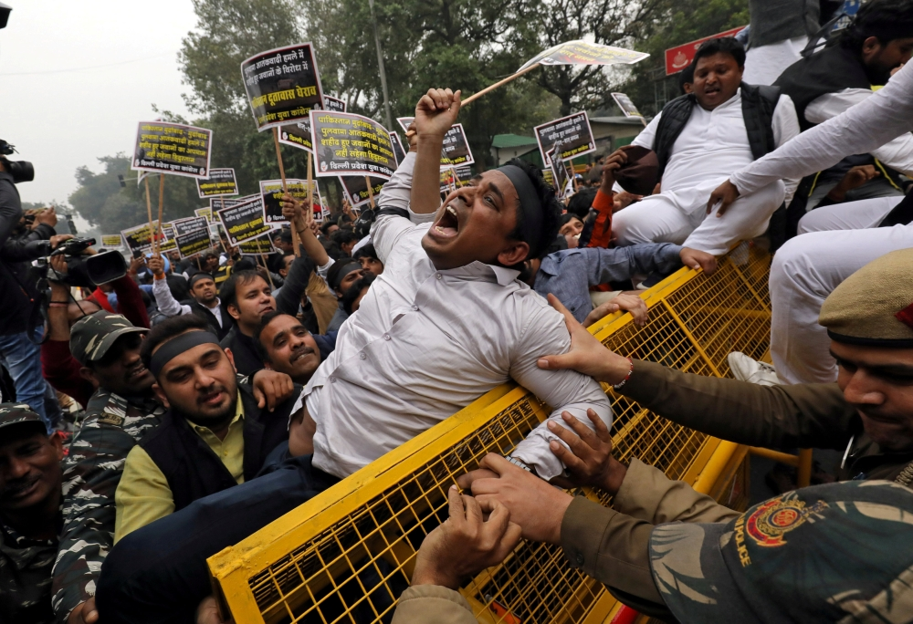 An activist of the youth wing of India's main opposition Congress party shouts slogans during a protest in New Delhi against the attack on a bus that killed 44 Central Reserve Police Force (CRPF) personnel in south Kashmir on Thursday. — Reuters