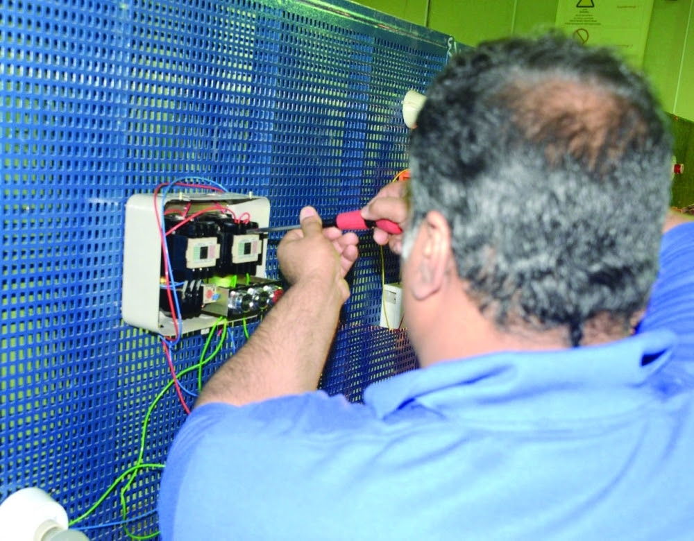 One of the inmates at Makkah Prison getting trained in electrical work.