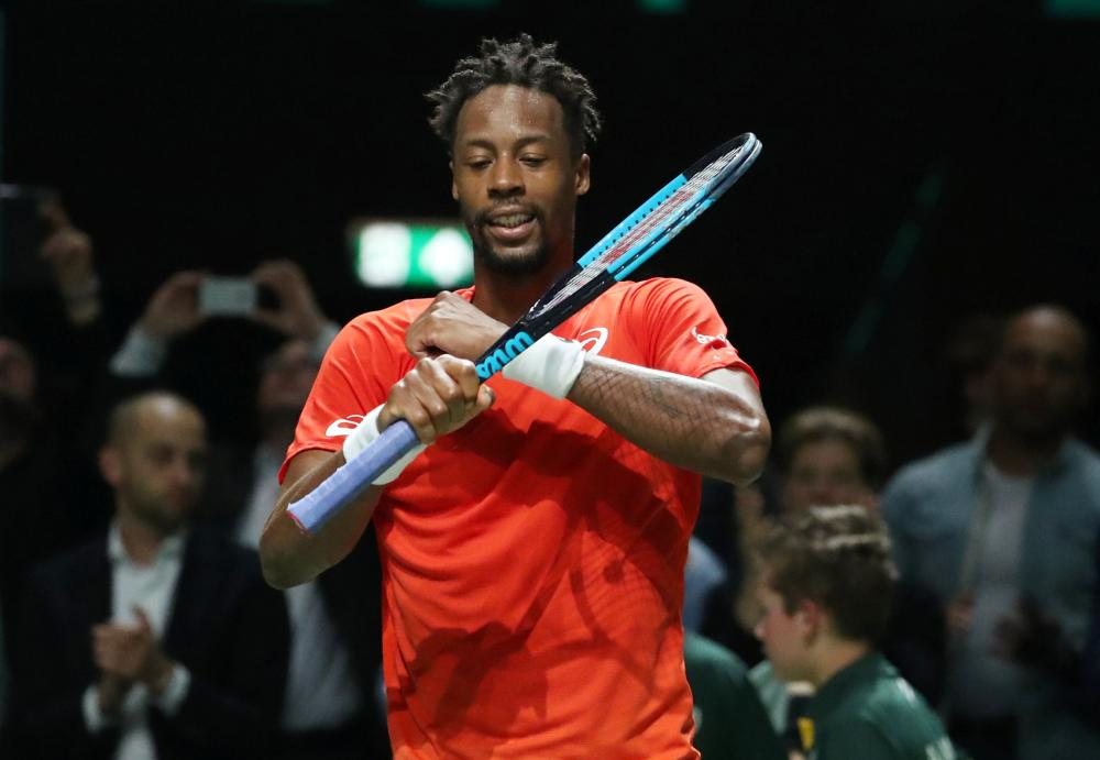 France's Gael Monfils celebrates winning his semifinal match against Russia's Daniil Medvedev at the Rotterdam Open Saturday. — Reuters