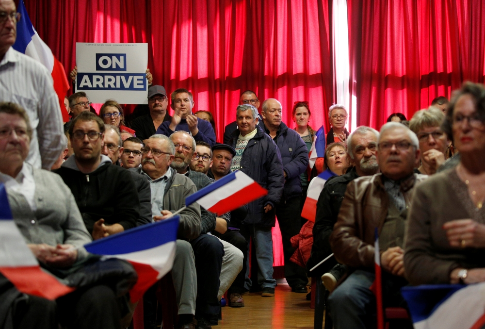 Supporters of French far-right National Rally (Rassemblement National) party attend a meeting in Saint-Paul-du-Bois, France, Fon Sunday. — Reuters