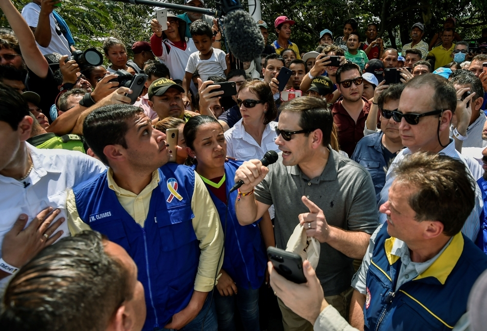 US senator Marco Rubio, center, speaks on a video call with Venezuelan opposition leader and self declared acting president Juan Guaido, at the Simon Bolivar international bridge in Cucuta, Colombia, border with San Antonio de Tachira, Venezuela, on Sunday. — AFP