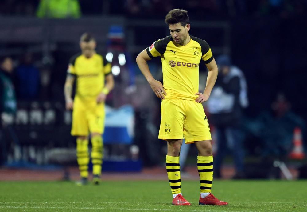 Borussia Dortmund's Raphael Guerreiro looks dejected at the end of the Bundesliga match against Nuremberg at Max-Morlock-Stadion, Nuremberg, Monday. — Reuters
