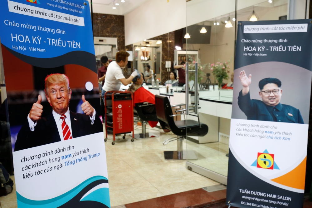 A barbershop offers free haircuts in the style of North Korean leader Kim Jong Un and US President Donald Trump in Hanoi, Vietnam, on Tuesday. — Reuters