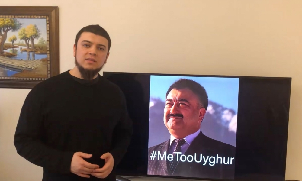 This handout frame grab made from video taken on February 11, 2019 and released by Arslan Hidayat shows Hidayat, the son-in-law of Uighur comedian Adil Mijit (R), calling for a