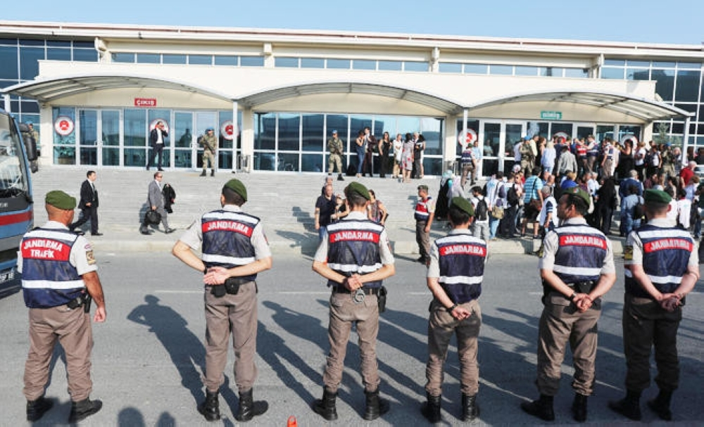 Soldiers stand guard outside the Silivri Prison and Courthouse complex during trial of 17 writers, executives and lawyers of the secularist Cumhuriyet newspaper in Silivri near Istanbul.— Reuters