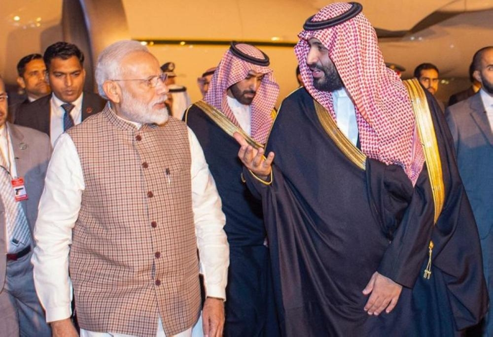 Crown Prince Muhammad Bin Salman, deputy premier and minister of defense, being received by Indian Prime Minister Narendra Modi at Air Force Station Palam airport in New Delhi on Tuesday evening. — Courtesy photo