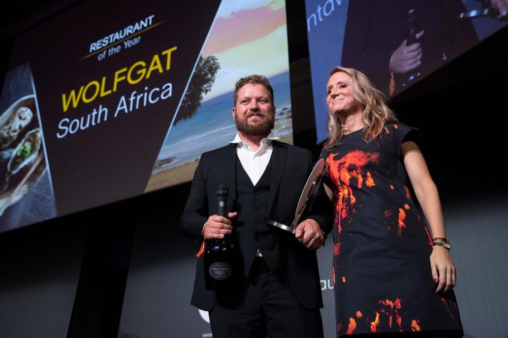 Chef Kobus van der Merwe (L) receives the best Restaurant of the year award for his restaurant