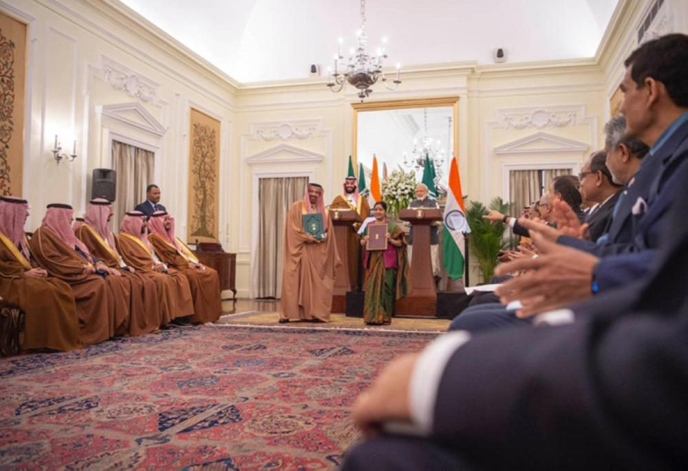 Crown Prince Muhammad Bin Salman, deputy premier and minister of defense, and Indian Prime Minister Narendra Modi supervise the signing of bilateral agreements as Minister of Energy, Industry and Mineral Resources Khalid Al-Falih and Indian Minister of External Affairs Sushma Swaraj exchange files at Hyderabad House in New Delhi on Wednesday. — SPA