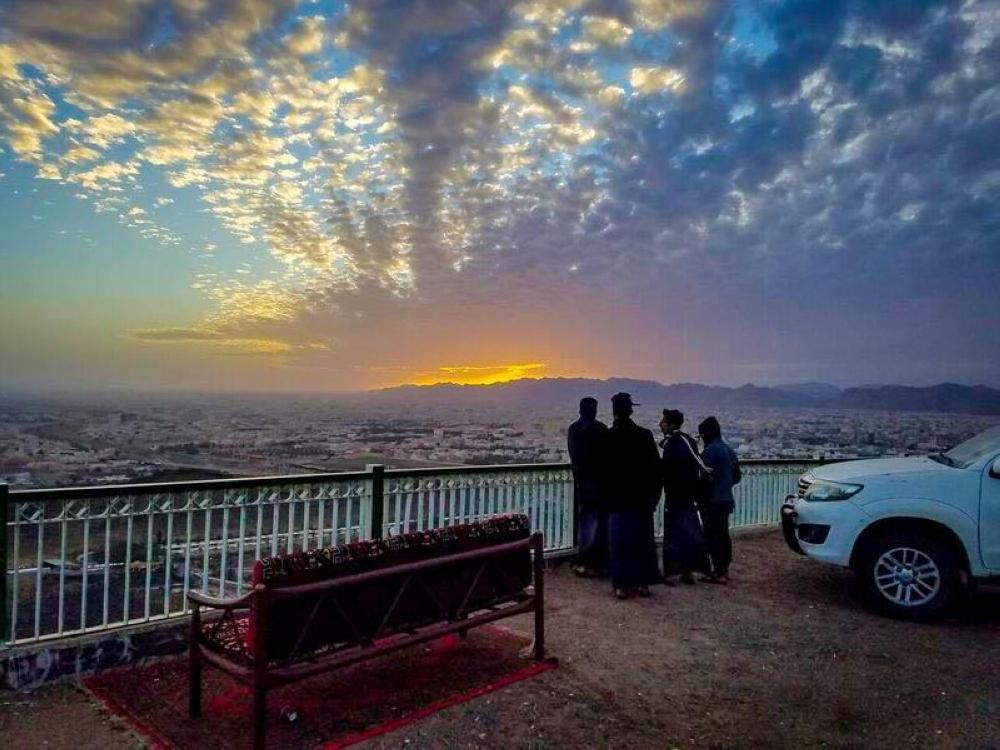 Tourists watch sunset from Al-Samraa Mountain in Hail.
