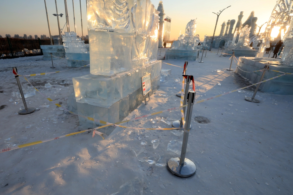 Security lines are seen set up for protecting visitors from falling ice from melting ice sculptures at the venue of the Harbin International Ice and Snow Sculpture Festival on its closing day, in Heilongjiang province, China. — Reuters