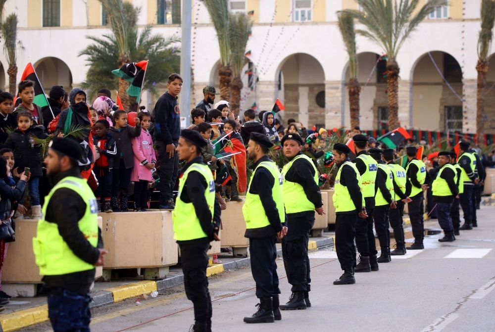 Libyan security forces form a human barrier as people gathered in the capital Tripoli's Martyrs Square celebrate a day ahead of the eighth anniversary of the Libyan revolution in this Feb. 16, 2019 file photo. — AFP