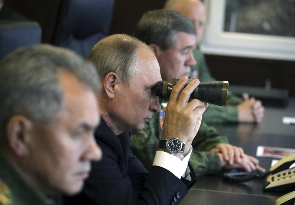Russian President Vladimir Putin uses a pair of binoculars while watching the Zapad-2017 war games, held by Russian and Belarussian servicemen, at a military training ground in the Leningrad region, Russia, in this Sept. 18, 2017 file photo. — Reuters