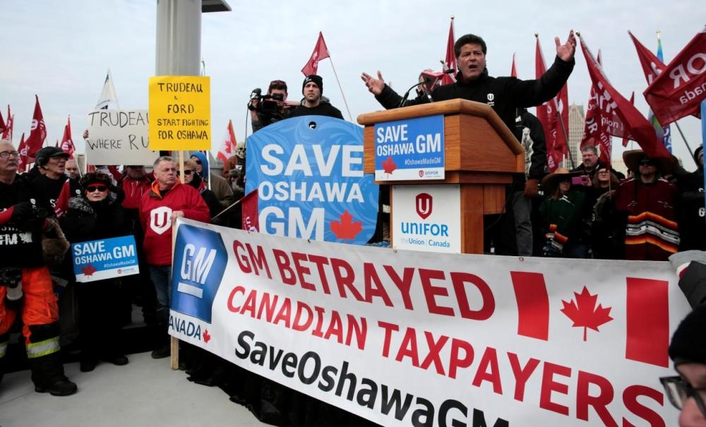 Unifor national president Jerry Dias addresses General Motors assembly workers and supporters protesting GM's announcement to close its Oshawa assembly plant during a rally across the Detroit River from GM's headquarters, in Windsor, Ontario, Canada, in this recent photo. — Reuters