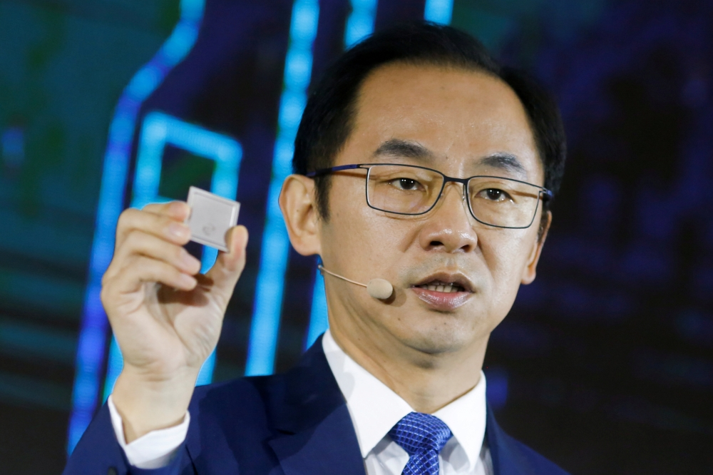 File photo shows Ryan Ding, the chief of Huawei's carrier business group, holding a Tiangang 5G base station chipset during a product presentation in Beijing, China. — Reuters