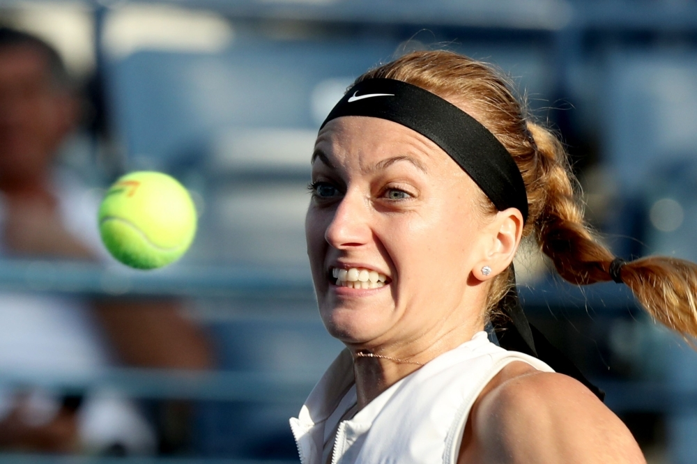 Petra Kvitova of Czech Republic eyes the ball as she plays against Viktoria Kuzmova of Slovakia during the WTA Dubai Duty Free Tennis Championship in the Gulf emirate of Dubai on Thursday. — AFP