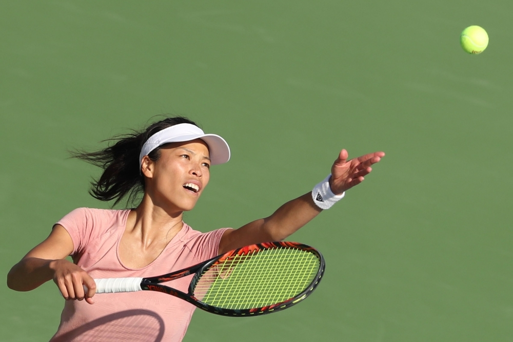 Taiwan's Hsieh Su-wei serves the ball to Czech Republic's  Karolina Pliskova during the WTA Dubai Duty Free Tennis Championship in the Gulf emirate of Dubai on Thursday. — AFP