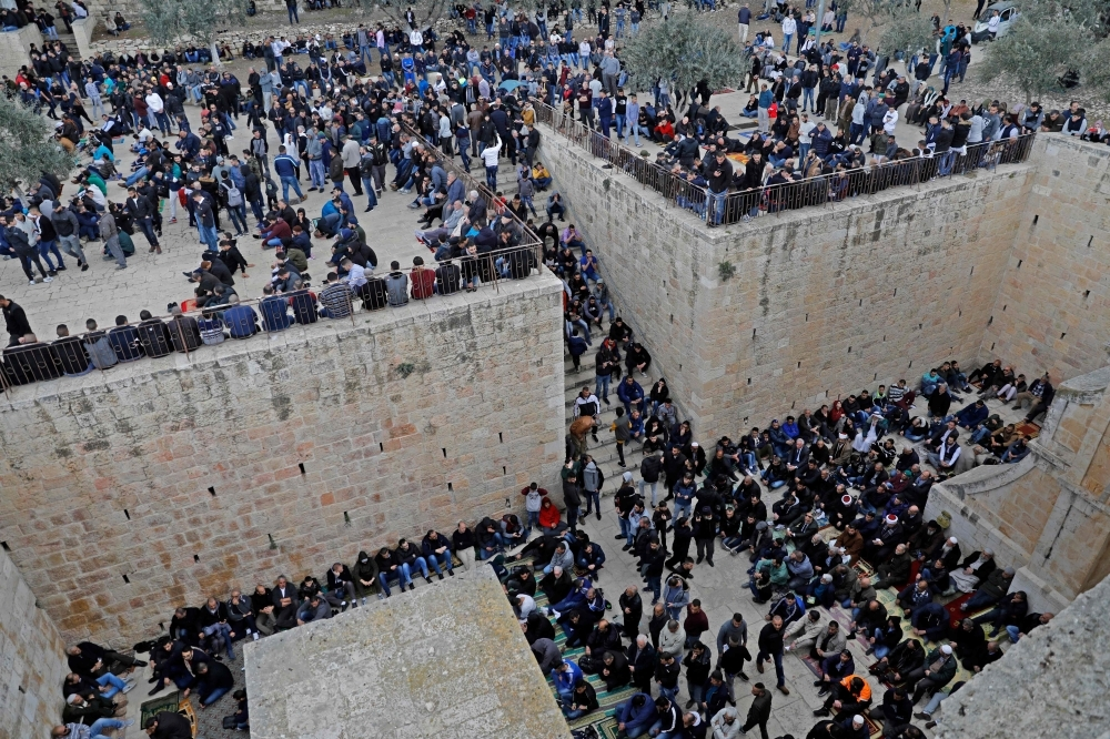 Palestinians worshipers gather before Friday noon prayers at the premises of the Golden Gate in Al-Aqsa Mosque compound in the Old City of Jerusalem, on Friday, after Jerusalem's grand mufti reportedly opened a gate leading to the site which was previously closed by Israeli authorities. — AFP