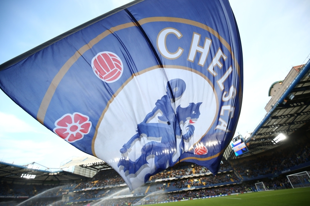 In this file photo a giant Chelsea flag flies before kick off of the English Premier League football match between Chelsea and Everton at Stamford Bridge in London.  Premier League club Chelsea have been banned from signing new players in the next two transfer windows as punishment for breaking rules on registering underage players, FIFA said on Friday. — AFP