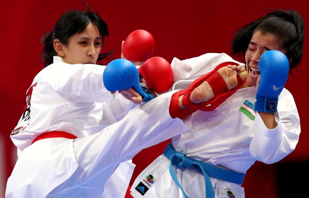 Karate bout between Bakhriniso Babaeva of Uzbekistan and Gu Shiaushaung of Taiwan at JCC Plenary Hall, Jakarta, Indonesia,in this file photo. — Reuters