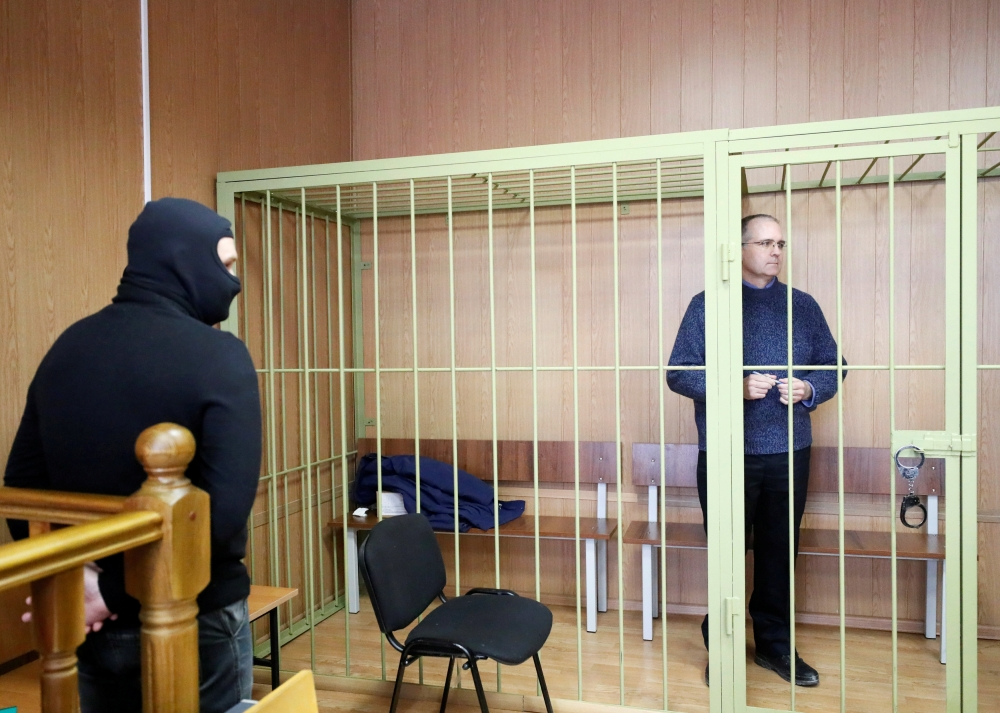 Former US marine Paul Whelan who is being held on suspicion of spying, stands in the courtroom cage after a ruling regarding extension of his detention, in Moscow, Russia, on Friday. — Reuters