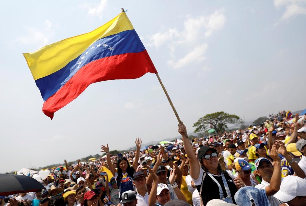"People attend the ""Venezuela Aid Live"" concert at the Tienditas cross-border bridge between Colombia and Venezuela, in Cucuta, Colombia, on Friday. — Reuters"