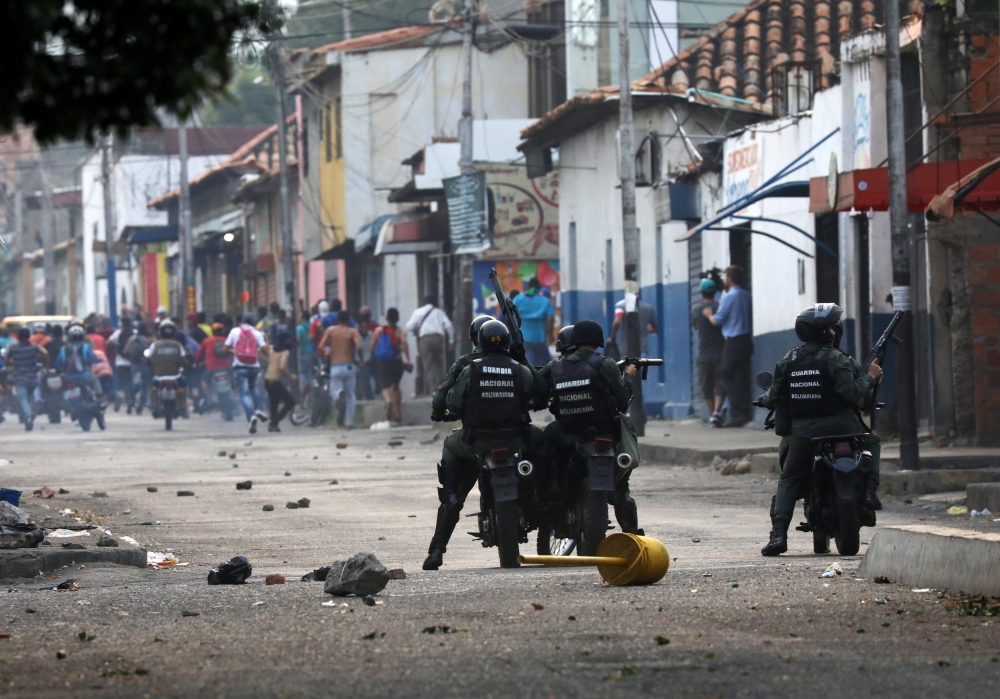 Venezuelan activists clash with security forces in Urena, Saturday. — Reuters
