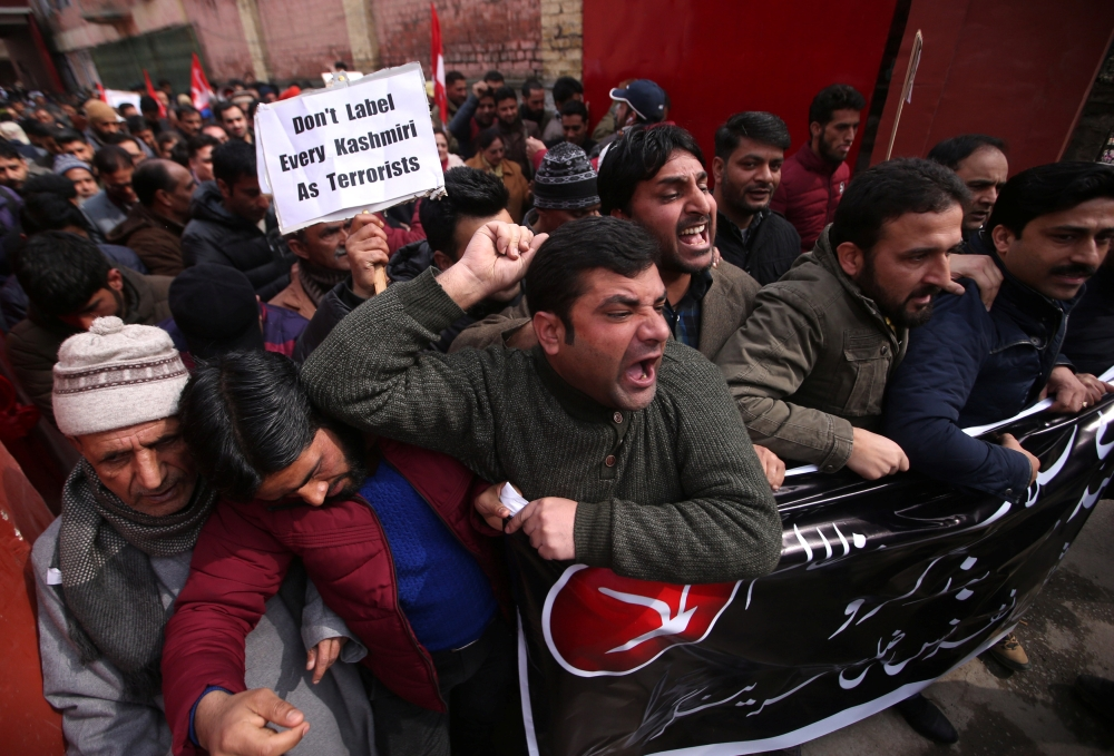 Activists of National Conference, one of the Kashmir's main pro-India political parties, shout slogans during a protest in Srinagar on Saturday against what the activists say is attacks on Kashmiris living outside their state. — Reuters