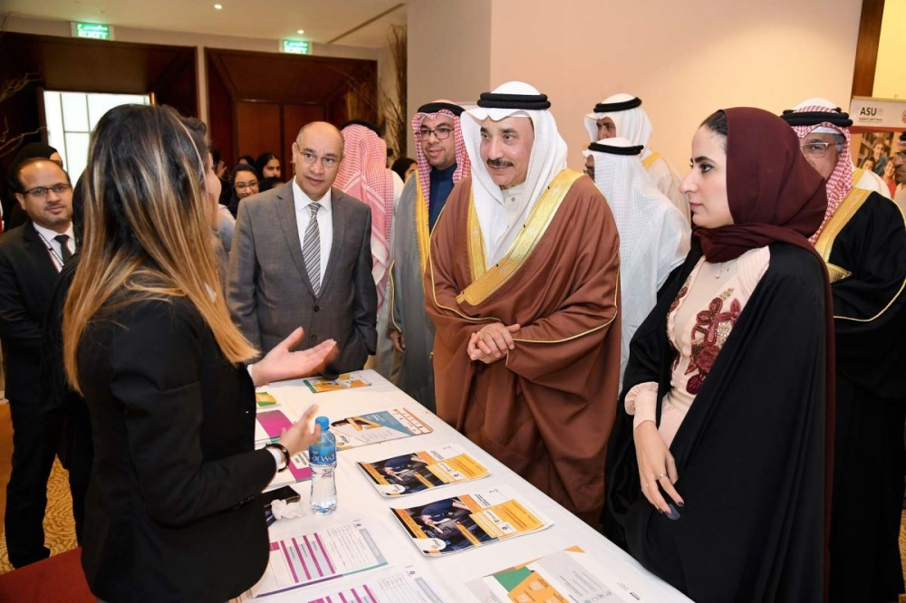 Jameel Bin Mohammed Ali Humaidan, minister of labor and social development, visits a pavilion at the Forsati ICT Job Fair in Manama. — Courtesy photo