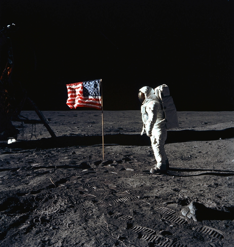 In this file photo taken on July 20, 1969, astronaut Edwin E. Aldrin, Jr., lunar module pilot of the first lunar landing mission, poses for a photograph beside the deployed US flag during Apollo 11 Extravehicular Activity (EVA) on the lunar surface area called the Sea of Tranquility.  — AFP