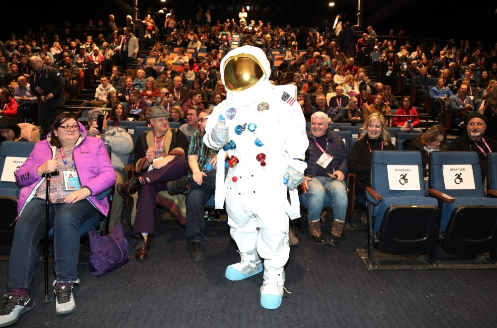 In this file photo taken on January 24, 2019 an astronaut poses with the audience during the