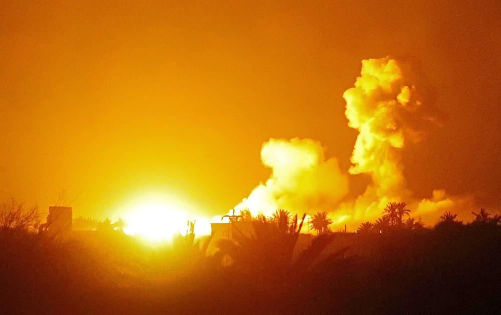 A picture taken in eastern Syrian province of Deir Ez-Zor shows explosions following shelling by the US-backed forces on Daesh group's embattled holdout of Baghouz. — AFP