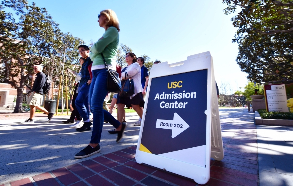 Adults and prospective students tour the University of Southern California (USC) in Los Angeles, California, Wednesday.