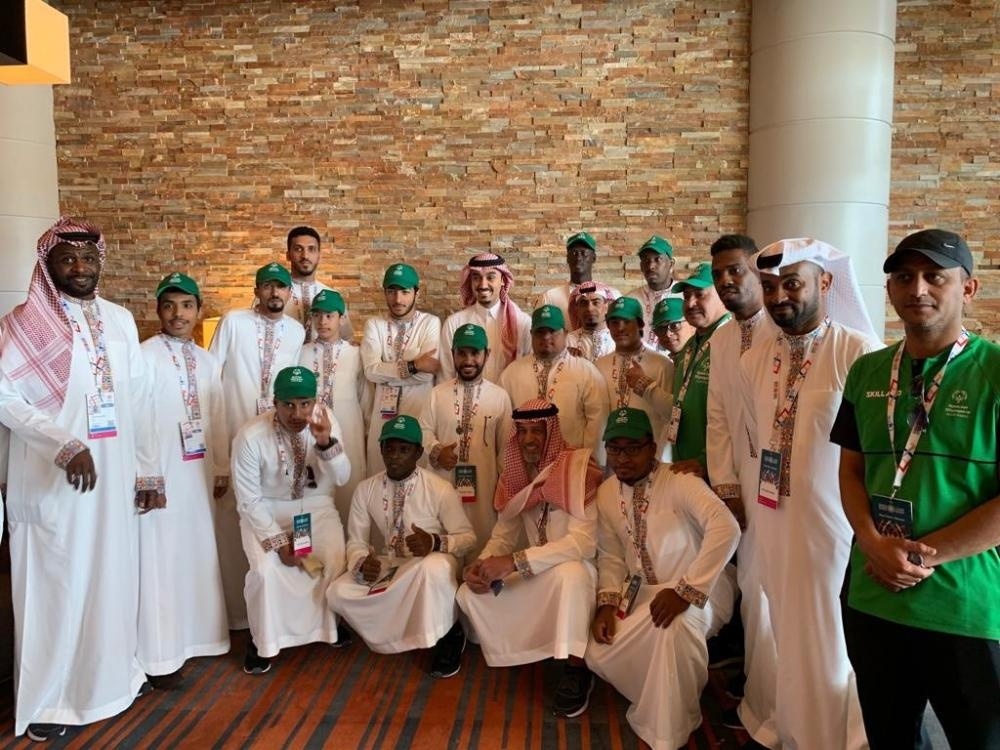 Prince Abdul Aziz Bin Turki Al-Faisal, chairman of the board of directors of the General Authority of Sports, poses for a photo with the Saudi team members taking part in the Special Olympics World Games in Abu Dhabi on Thursday. — SPA