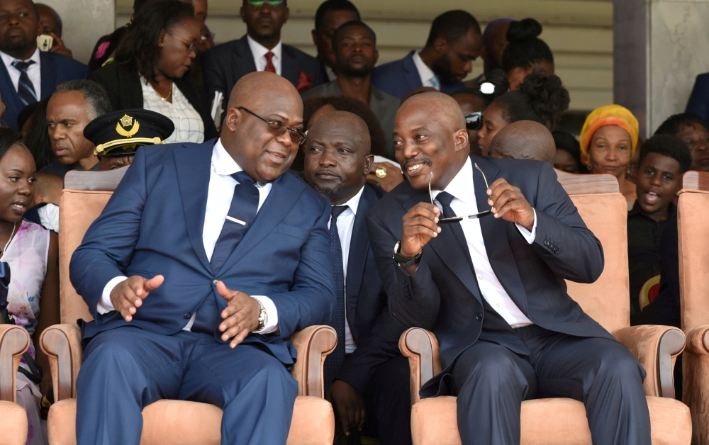 Democratic Republic of Congo's outgoing President Joseph Kabila sits next to his successor Felix Tshisekedi during the inauguration ceremony in this Jan. 24, 2019 file photo. — Reuters