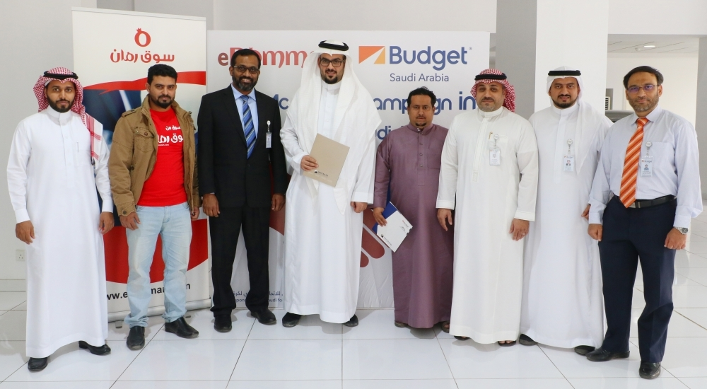 Budget & eRomman officials at the joint marketing campaign deal. — Courtesy photo