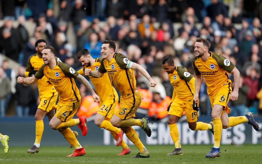 Brighton's players celebrate after the FA Cup quarterfinal match against Millwall at The Den, London, Sunday. — Reuters