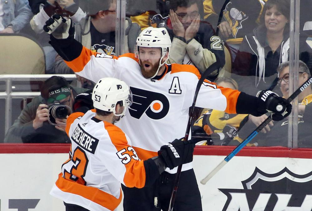 Philadelphia Flyers' center Sean Couturier celebrates after scoring the game-winning goal with defenseman Shayne Gostisbehere (53) against the Pittsburgh Penguins in overtime at PPG Paints Arena in Pittsburgh Sunday. — Reuters