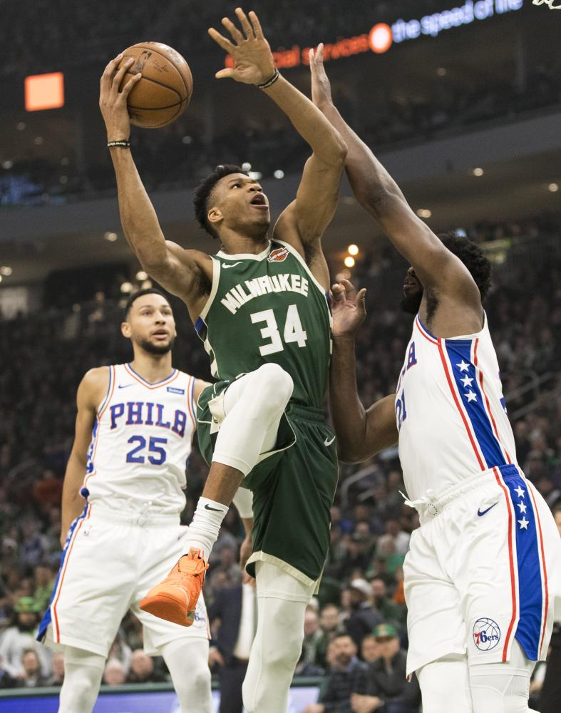 Milwaukee Bucks' forward Giannis Antetokounmpo shoots against Philadelphia 76ers' center Joel Embiid during their NBA game at Fiserv Forum in Milwaukee Sunday. — Reuters