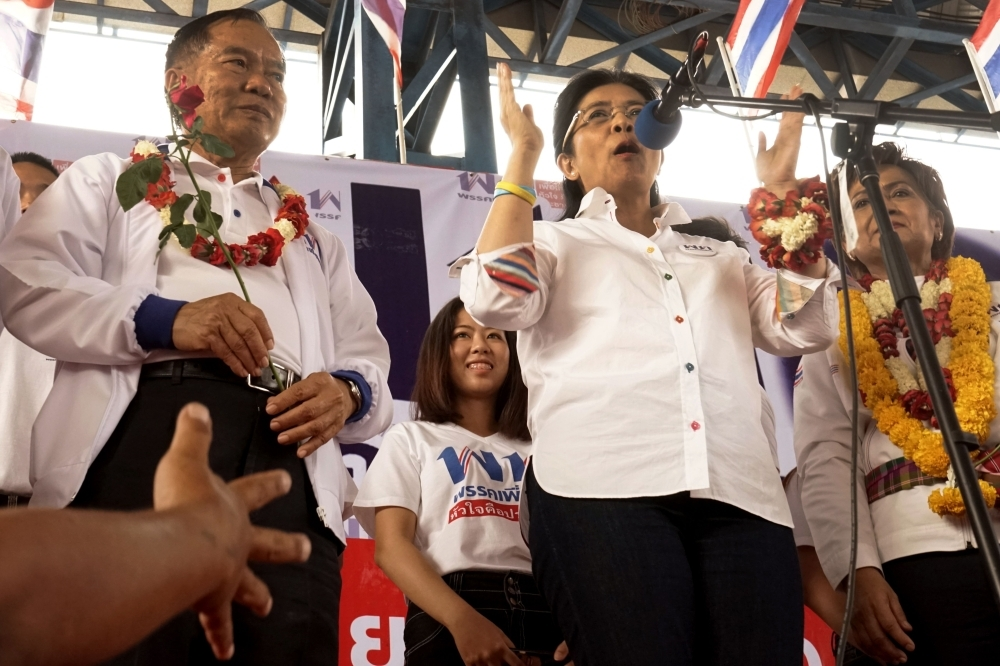 Pheu Thai party candidate for prime minister Sudarat Keyuraphan, center, speaks during a rally in Chaiyaphum province on Monday, ahead of the March 24 general election.  — AFP